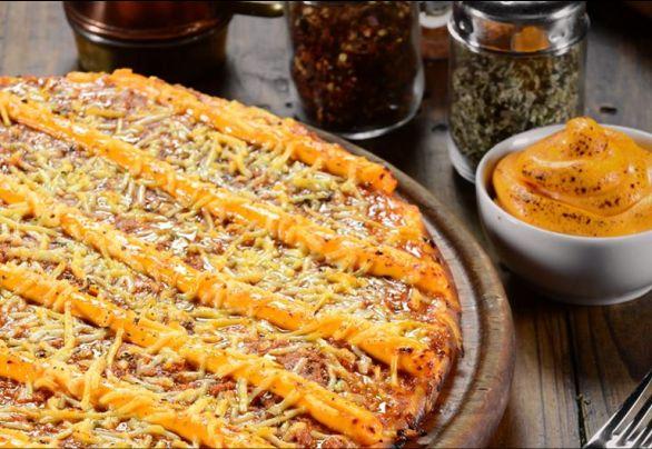 Com flocos de manteiga e até farinha integral; conheça o segredo das pizzarias do Clube