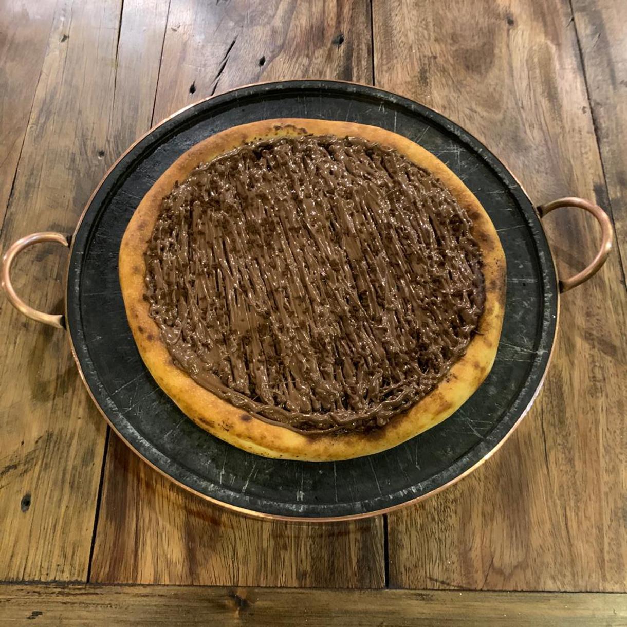 Conheça a pizza de tiramissù do restaurante O Jardineiro